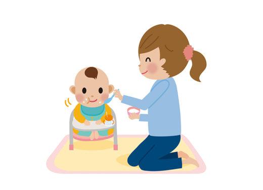 赤ちゃんにご飯を食べさせるイラスト