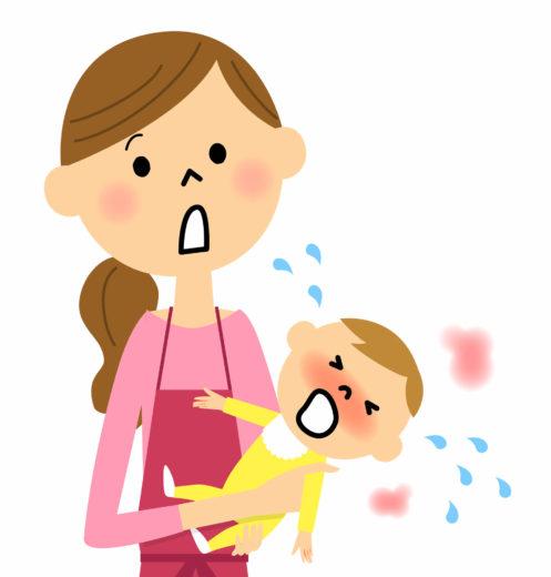 泣き出した赤ちゃんをあやす母